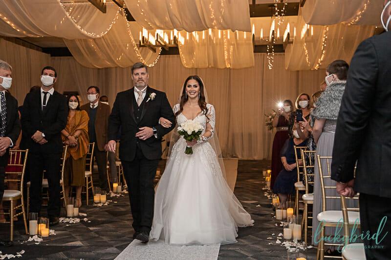 bride coming down the aisle at renaissance toledo