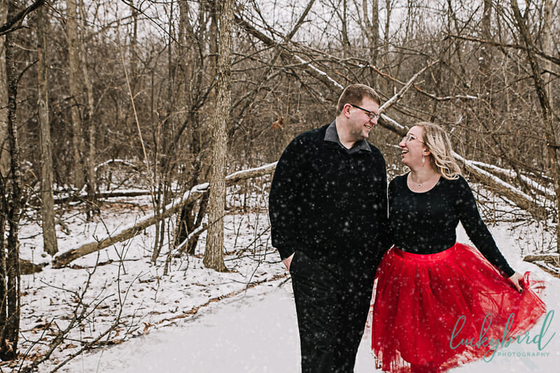 snowy engagement session in red skirt toledo