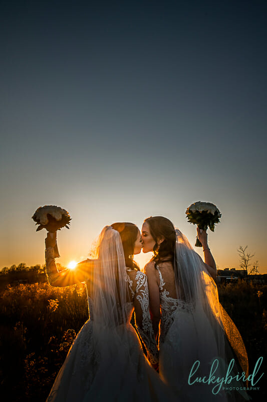two brides during sunset photos