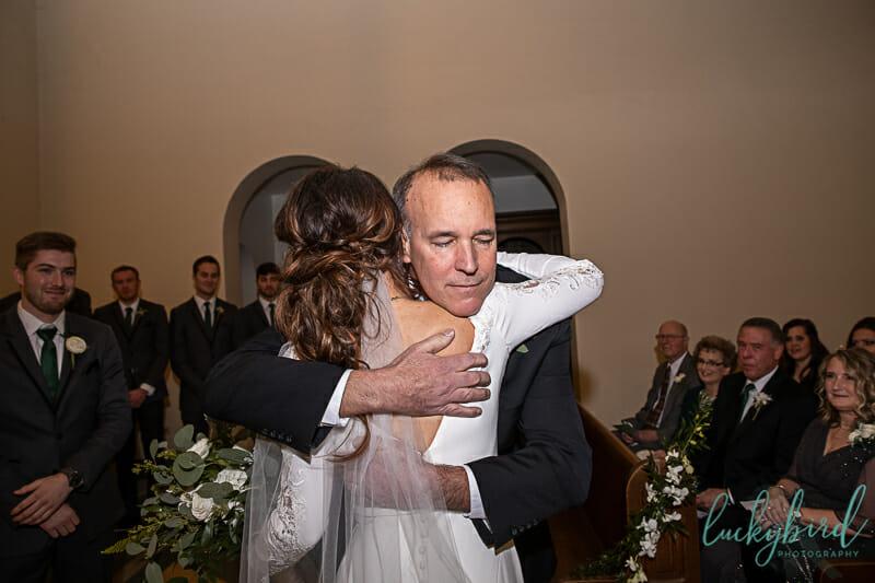 hug at nazareth hall chapel wedding