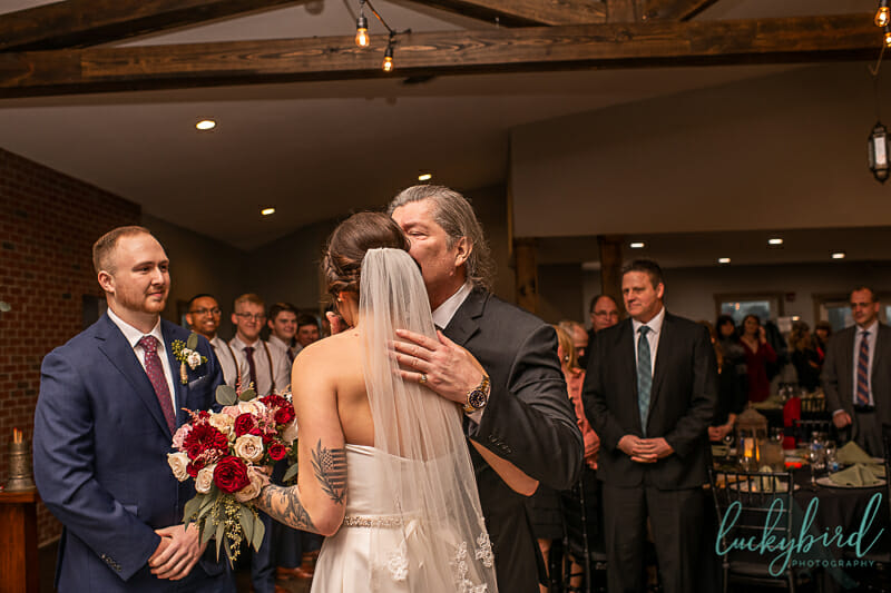dad giving away bride at the barn at walnut creek wedding ceremony