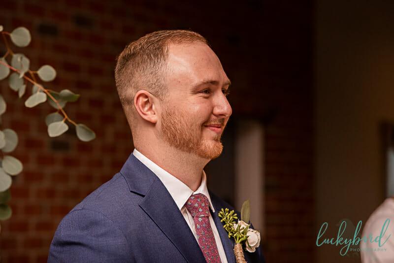 groom seeing bride at the barn at walnut creek wedding