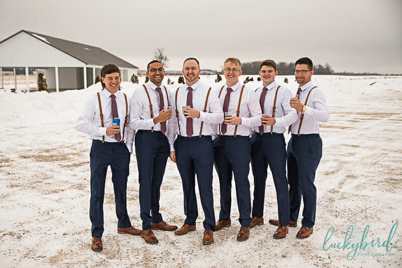 groomsmen with drinks at the barn at walnut creek wedding