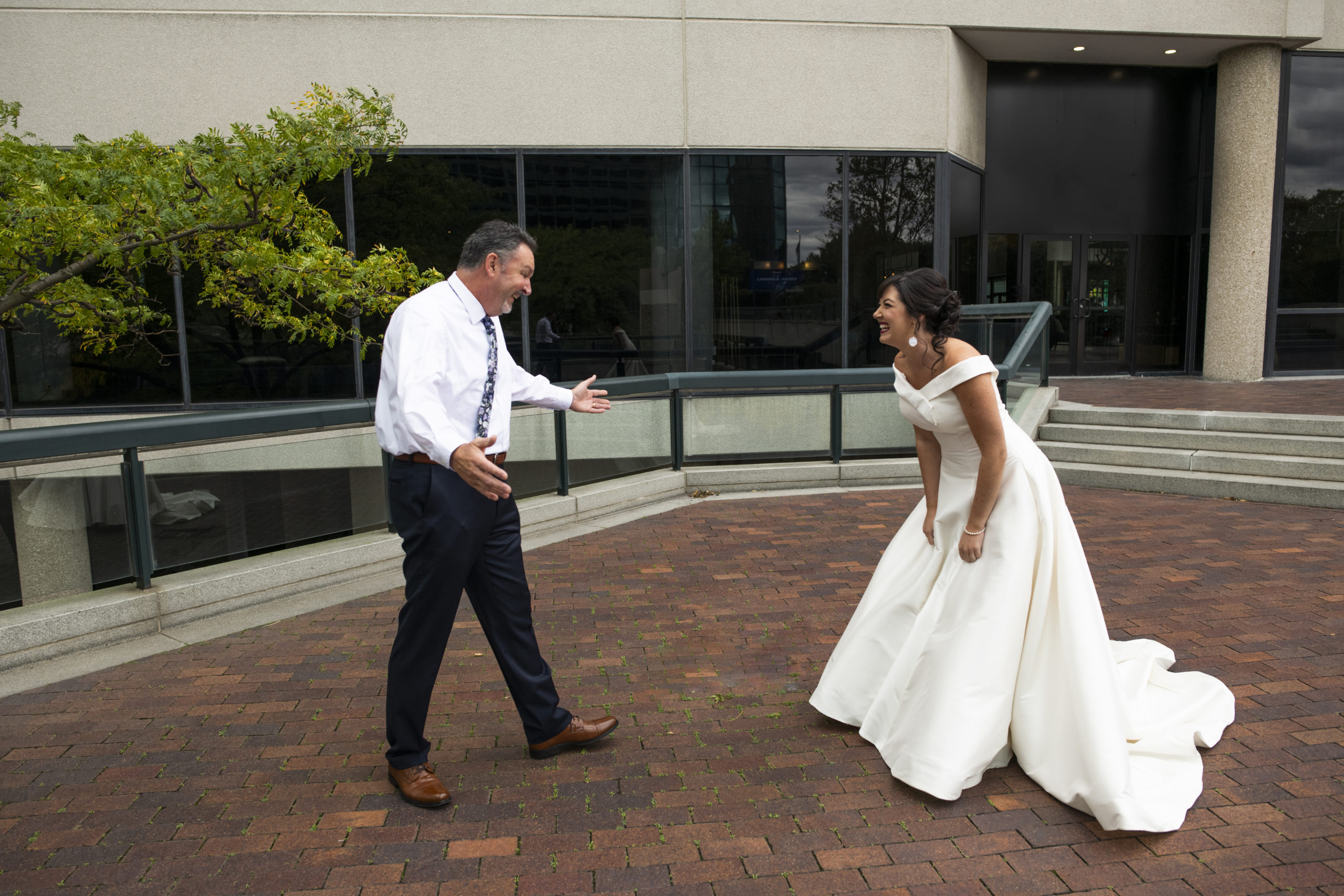 bride and dad first look photo at renaissance toledo hotel