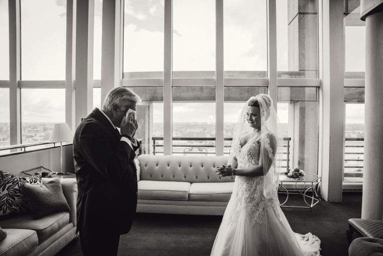 bride and dad crying at downtown toledo wedding venue