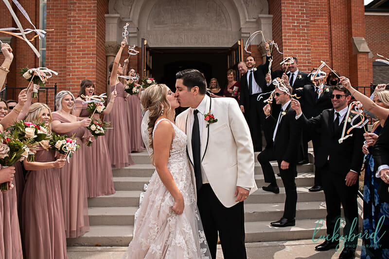 bride and groom ribbon wand exit at st joseph maumee