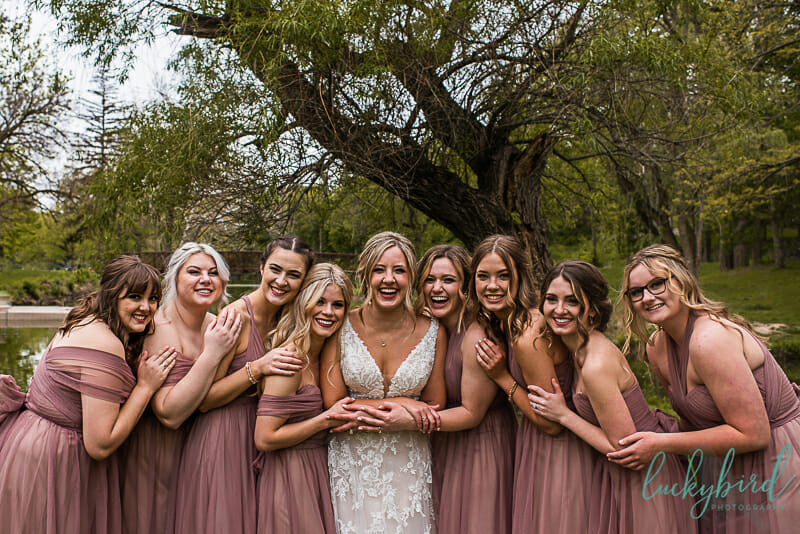 bridesmaids laughing candid wedding photo