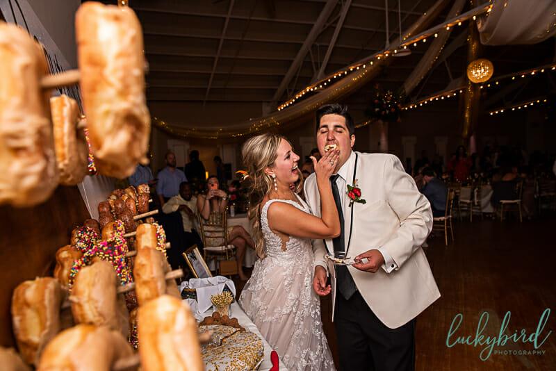 feeding donut cake during wedding
