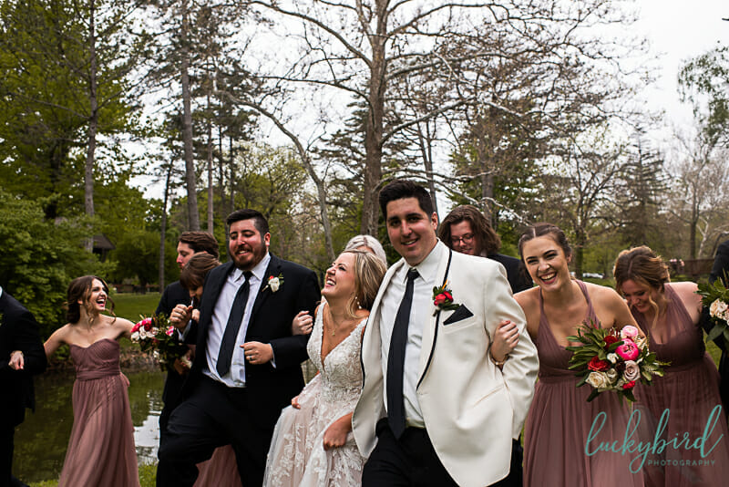 fun laughing wedding party photo