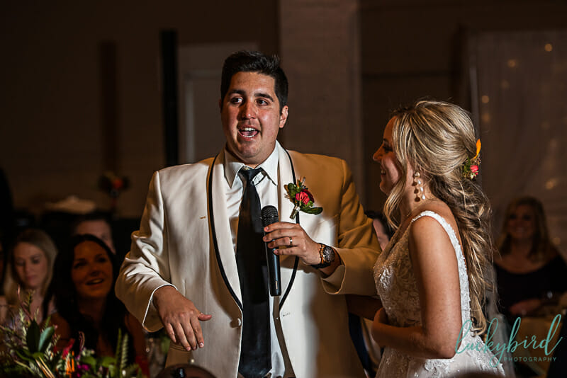 groom giving toast on dance floor at the armory