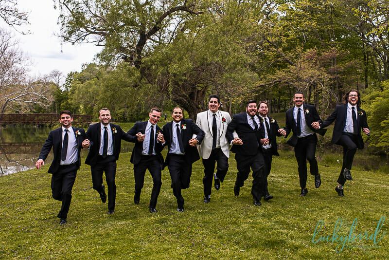 groomsmen skipping fun photo