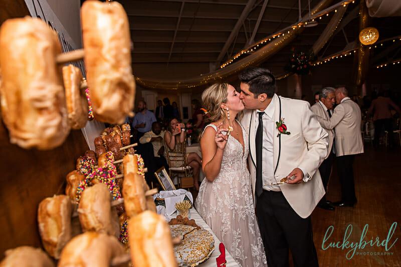 kiss during wedding cake cutting