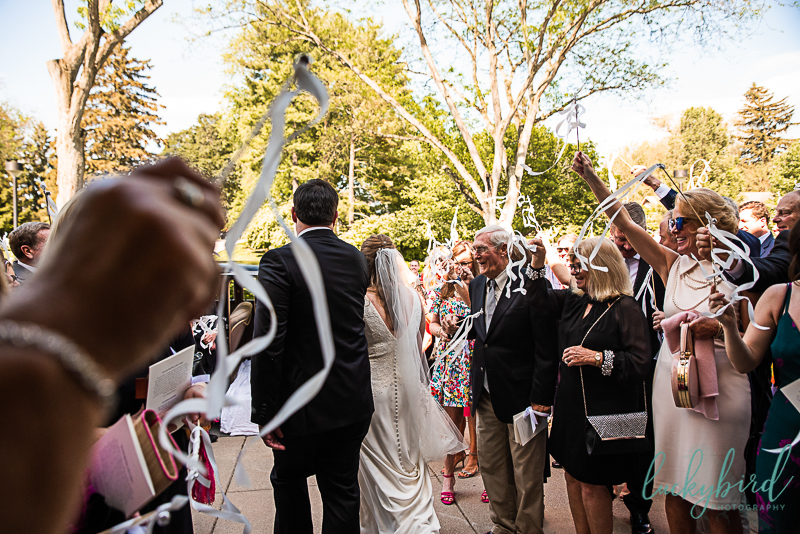 ribbon wand exit from church during wedding ceremony