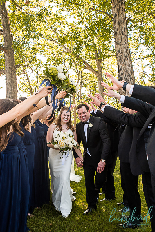 tunnel wedding party photo hands and bouquets