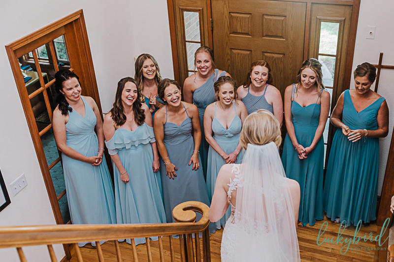 bride and bridesmaids first look on staircase