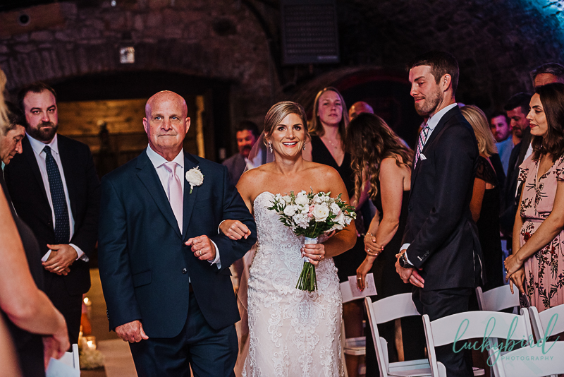 bride and father walking down the aisle at gideon owen wine cellar wedding ceremony