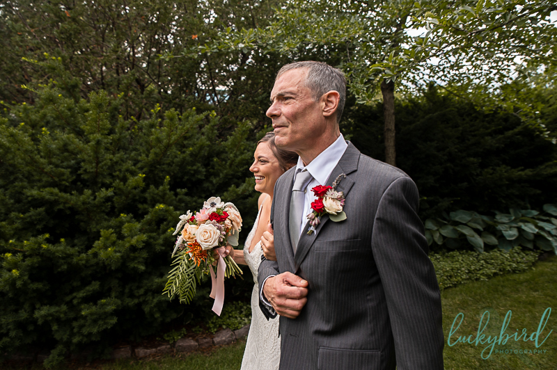 bride and father walking down the aisle at toledo zoo wedding