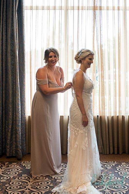 bride getting into wedding dress hilton garden inn