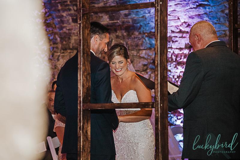 bride laughing at gideon owen wine cellar wedding ceremonybride laughing at gideon owen wine cellar wedding ceremony