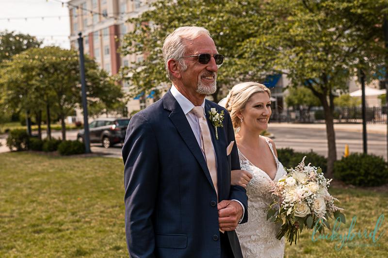 walking bride down aisle at outdoor perrysburg hilton ceremony