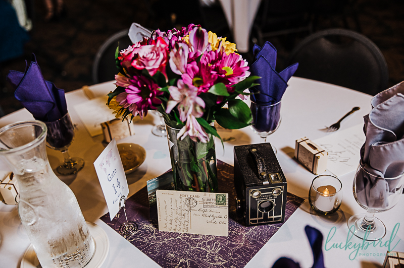 camera and travel themed wedding centerpieces