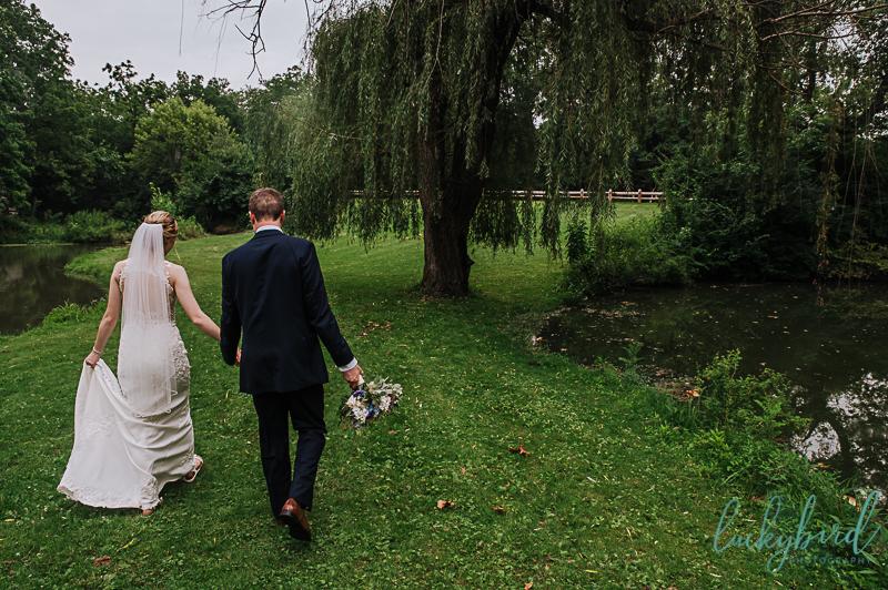 couple walking during sidecut wedding photos