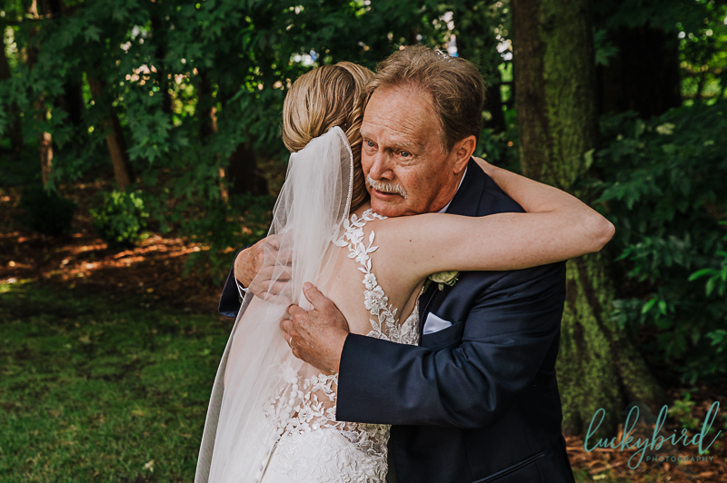 father daughter wedding first look photo