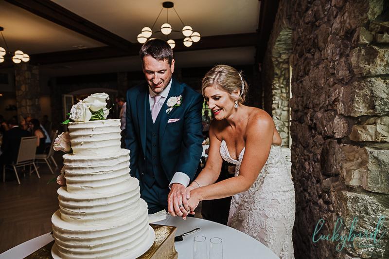 gideon owen cake cutting with wedding couplegideon owen cake cutting with wedding couple
