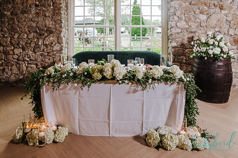 gideon owen wedding ceremony with forevermore flowers and decor