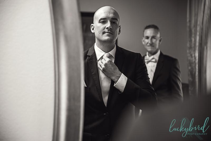 groom getting ready at hilton garden inn