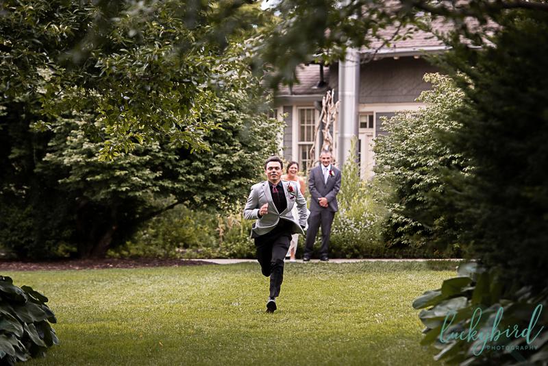 groom running down the aisle