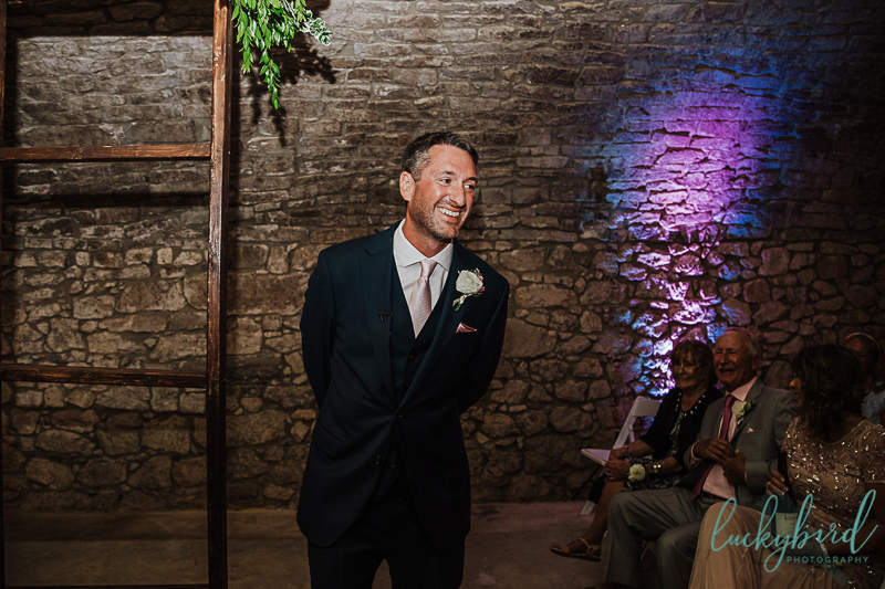 groom seeing bride at gideon owen wine cellar wedding ceremony