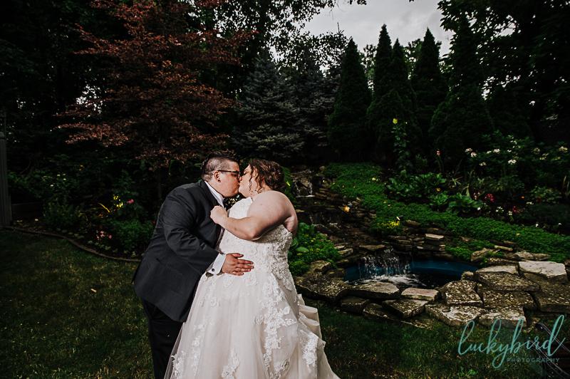 holland gardens wedding photo by waterfall