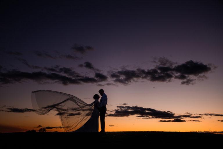 sunset photo with wedding veil and ohio sunset
