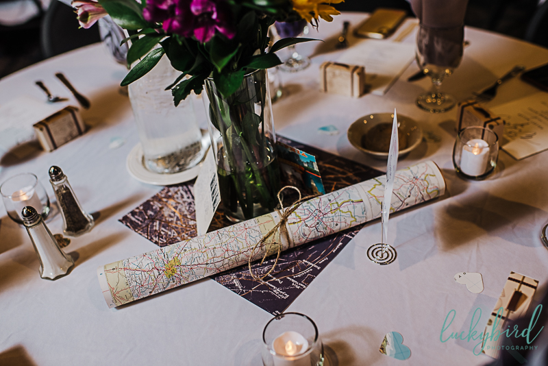 wedding centerpieces with maps and travel