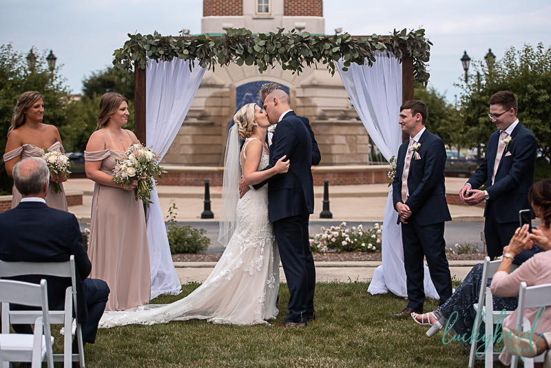 wedding kiss at levis commons perrysburg ceremony
