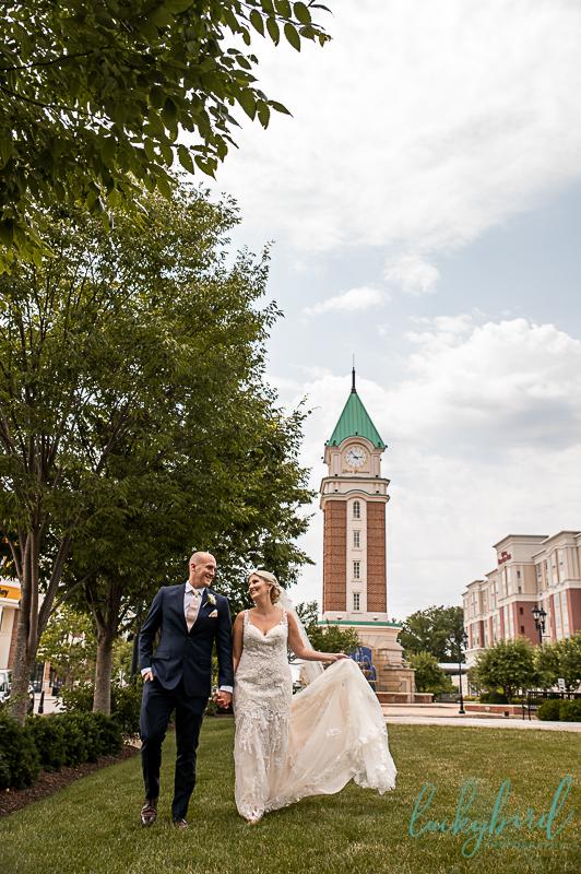wedding photos at levis commons clock tower perrysburg