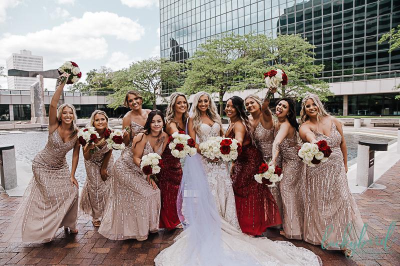 bride and bridesmaids having fun at renaissance toledo wedding