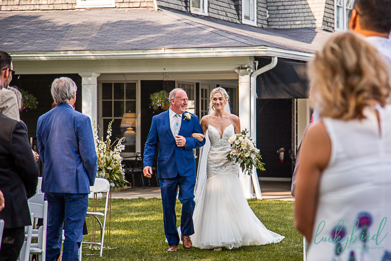 bride-and-dad-walking-down-the-aisle-toledo-country-club