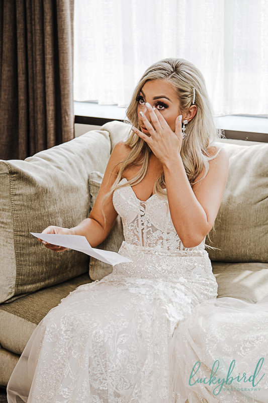 bride crying while reading grooms note at downtown toledo renaissance hotel