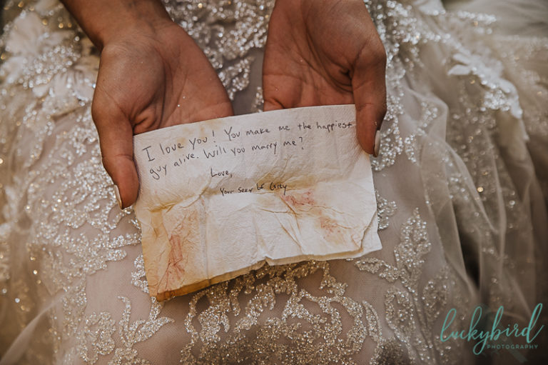 bride holding note from groom