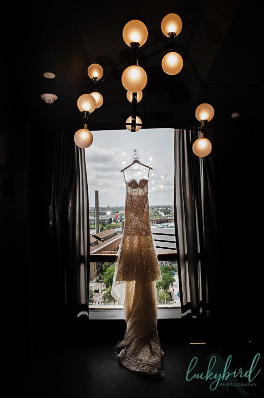 brides dress hanging at renaissance toledo