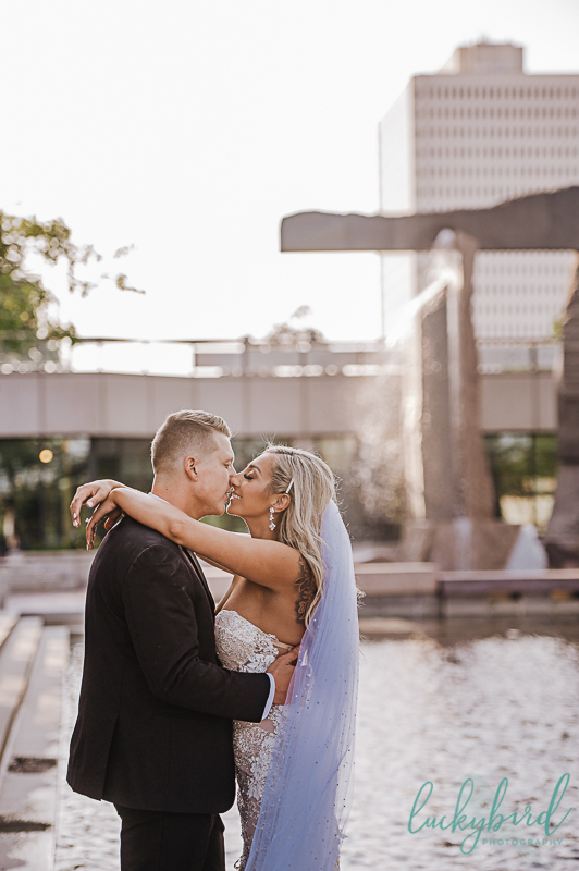 couple kissing at renaissance toledo wedding photos