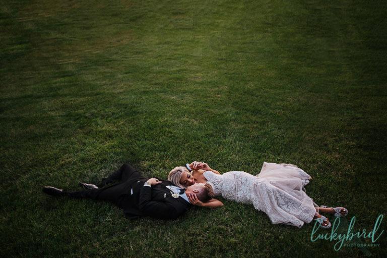 downtown toledo wedding photo in grass
