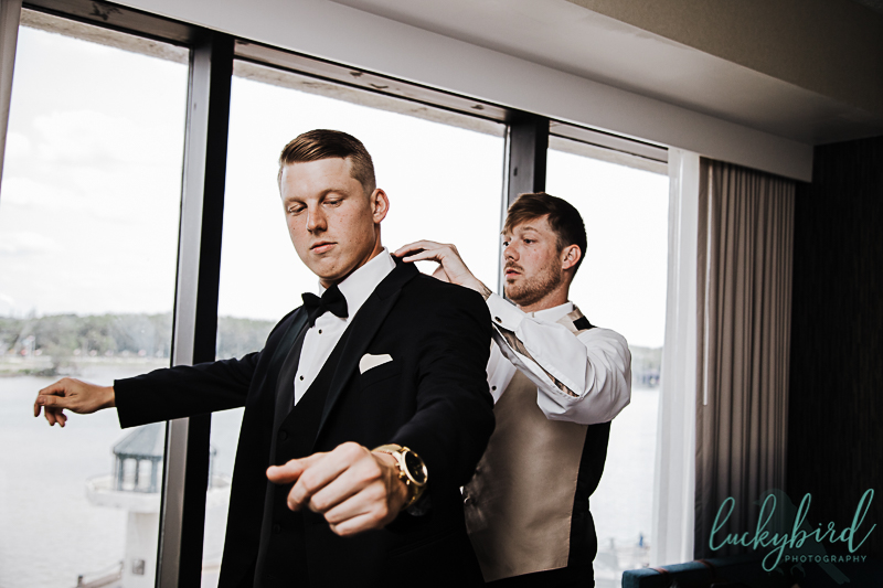 groom getting into suit at renaissance toledo