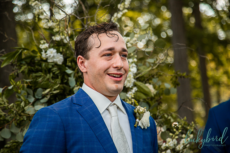 groom-seeing-bride-walk-down-the-aisle-at-outdoor-toledo-country-club-wedding