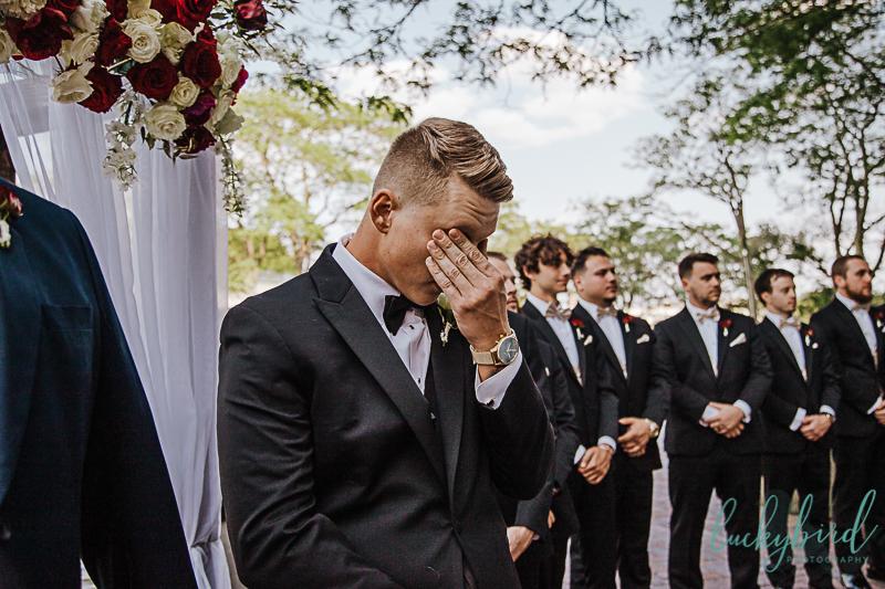 grooms reaction to seeing bride during renaissance toledo wedding ceremony