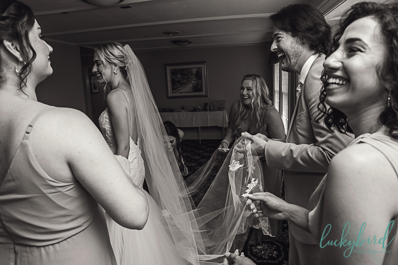 helping-bride-get-ready-at-toledo-country-club