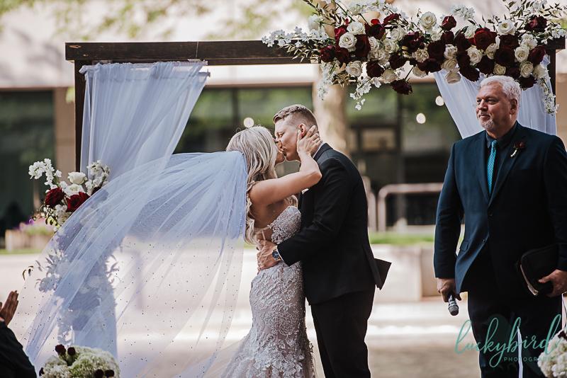 kissing after wedding ceremony at renaissance toledo