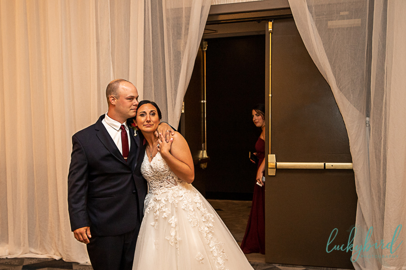 bride-and-groom-seeing-reception-space-at-renaissance-toledo
